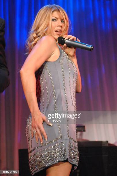 Fergie of the Black Eyed Peas performs during 2007 Clive Davis PreGRAMMY Awards Party Show at Beverly Hills Hilton in Beverly Hills California United...
