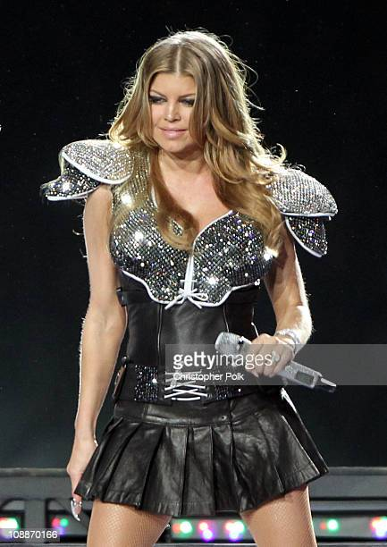 Fergie of The Black Eyed Peas performs during the Bridgestone Super Bowl XLV Halftime Show at Dallas Cowboys Stadium on February 6 2011 in Arlington...