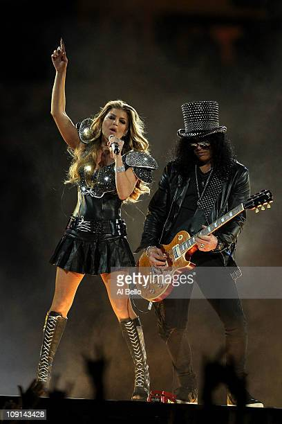 Fergie of the Black Eyed Peas performs with Slash during the Bridgestone Super Bowl XLV Halftime Show at Cowboys Stadium on February 6 2011 in...