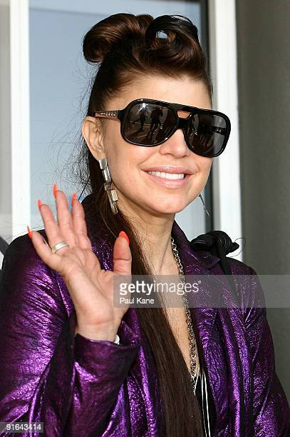 Fergie of the Black Eyed Peas waves to fans after arriving at Perth Airport after the 'Mile High Club' InFlight Karaoke gig on a Virgin Blue Flight...