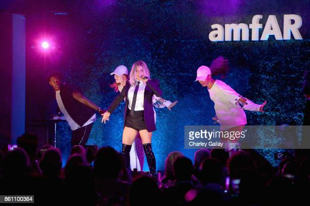 Fergie performs onstage at the amfAR Gala Los Angeles 2017 at Ron Burkle's Green Acres Estate on October 13 2017 in Beverly Hills California