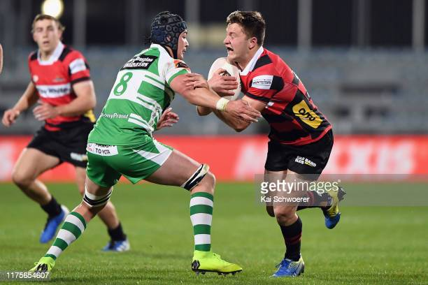 Fergus Burke of Canterbury is tackled by Brayden Iose of Manawatu during the round 7 Mitre 10 Cup match between Canterbury and Manawatu at...