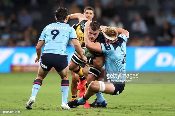 Fergus Lee-Warner of the Force is tackled during the round three Super RugbyAU match between the Waratahs and the Western Force at Bankwest Stadium,...