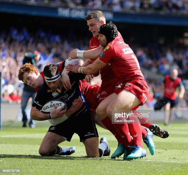 Fergus McFadden of Leinster is tackled by Leigh Halfpenny Rhys Patchell and Scott Williams during the European Rugby Champions Cup SemiFinal match...