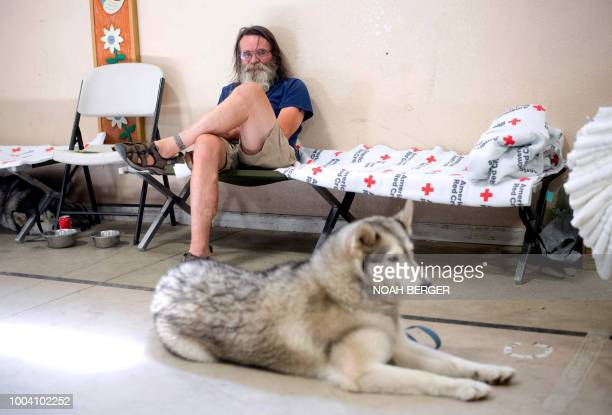 Ferguson fire evacuee Dan Powell and his dog Amber wait in a Red Cross shelter in Mariposa California on July 22 2018 A fire that claimed the life of...