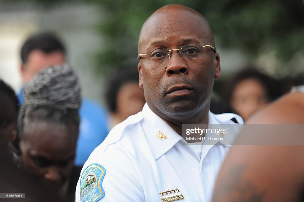 Ferguson Police Chief Andre Anderson watches on during a candlelight vigil held in honor of Jamyla Bolden on August 20, 2015 in Ferguson, Missouri. Jamyla Bolden, 9, was allegedly struck by a stray bullet from a drive-by shooting and killed while doing her homework at her home in Ferguson on August 18th.