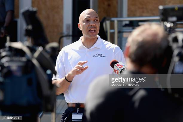 Ferguson Police Chief, Jason Armstrong speaks to media as volunteers help cleanup from an overnight clash between protesters and law enforcement at...