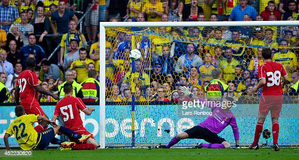 Ferhan Hasani of Brondby IF scoring their second goal against Goalkeeper Danny Ward of Liverpool FC during the PreSeason Friendly match between...