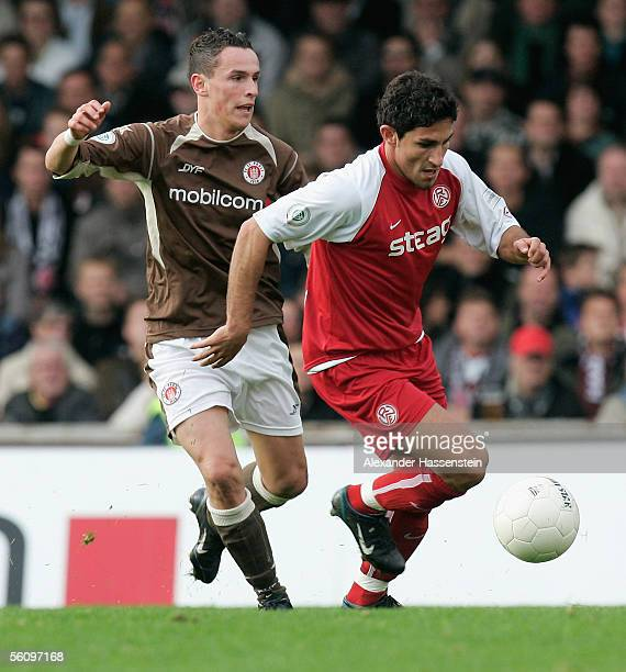 Ferhat Kirscanc of Essen challenges for the ball with Felix Luc of St Pauli during the match of the Third Bundesliga between FC St Pauli and Rot...
