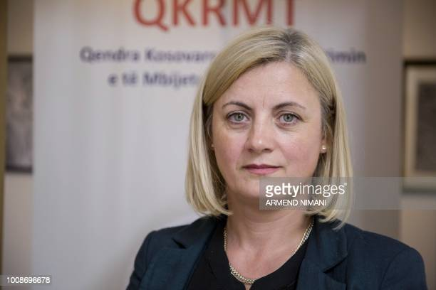 Feride Rushiti head of the Kosovo Rehabilitation Centre for Torture Victims poses in her office in Pristina on July 24 2018 Rights groups estimate up...
