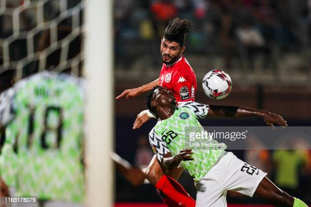 Ferjani Sassi of Tunisia and Kenneth Josiah omeruo of Nigeria during the 3rd place African Nations Cup match between Tunisia and Nigeria on 14th July...