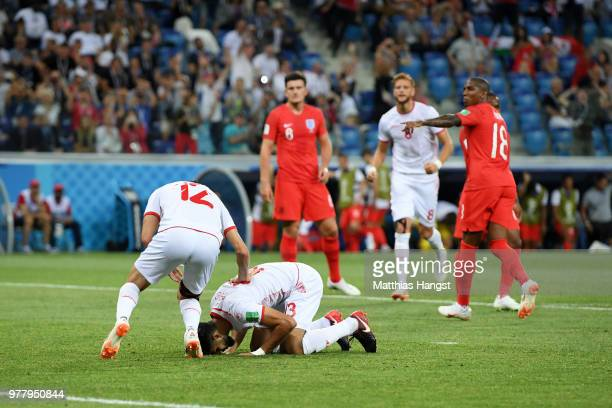 Ferjani Sassi of Tunisia is helped by team mate Ali Maaloul after gainig a penalty during the 2018 FIFA World Cup Russia group G match between...