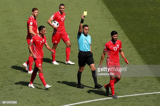 Ferjani Sassi of Tunisia is shown a yellow card by referee Jair Marrufo during the 2018 FIFA World Cup Russia group G match between Belgium and...