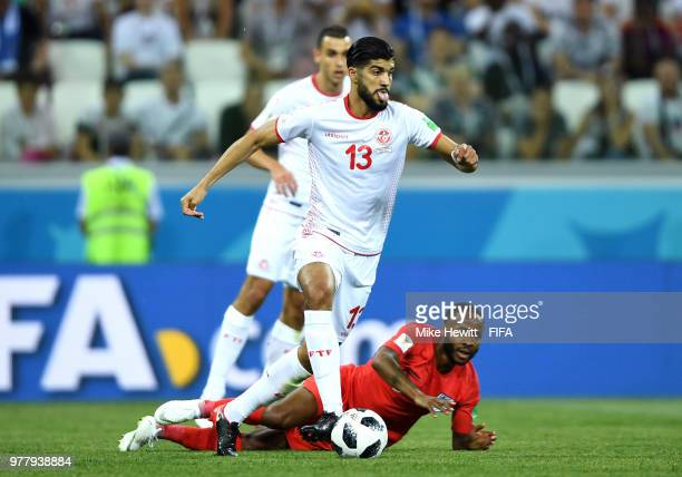 Ferjani Sassi of Tunisia runs with the ball away from Raheem Sterling of England during the 2018 FIFA World Cup Russia group G match between Tunisia...