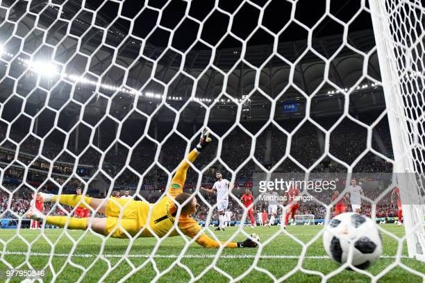 Ferjani Sassi of Tunisia scores his sides first goal from a penalty past Jordan Pickford of England to make the score 11 during the 2018 FIFA World...
