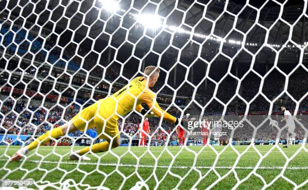 Ferjani Sassi of Tunisia scores his sides first goal pass Jordan Pickford of England to make the score 11 during the 2018 FIFA World Cup Russia group...