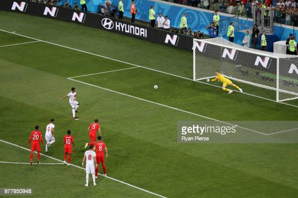 Ferjani Sassi of Tunisia shoots and scores a penalty his side's first goal past Jordan Pickford of England during the 2018 FIFA World Cup Russia...