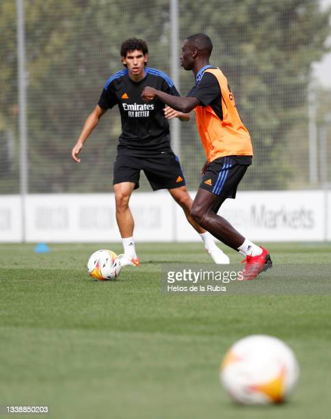 Ferland Mendy and Jesús Vallejo both of Real Madrid are training at Valdebebas training ground on September 07, 2021 in Madrid, Spain.