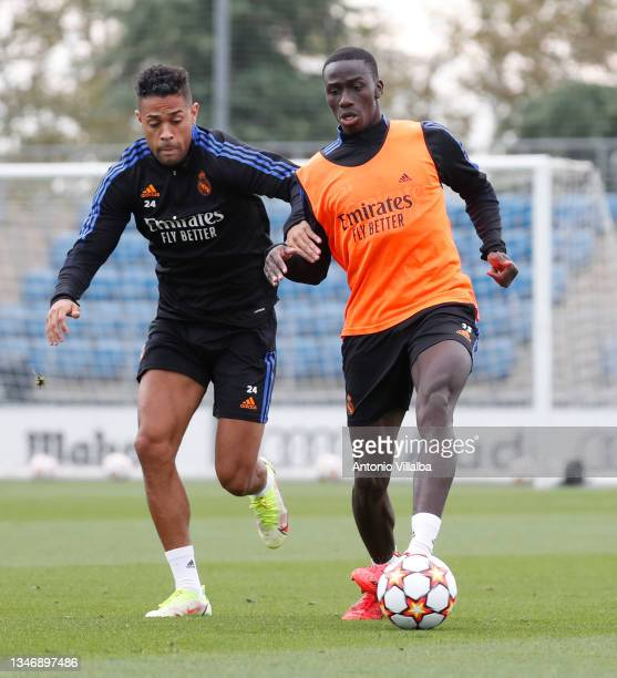Ferland Mendy and Mariano Díaz of Real Madrid are training at Valdebebas training ground on October 16, 2021 in Madrid, Spain.