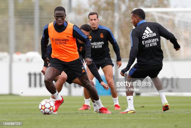 Ferland Mendy and Rodrygo Goes of Real Madrid are training with teammates Lucas Vázquez and Carlos Casemiro at Valdebebas training ground on October...