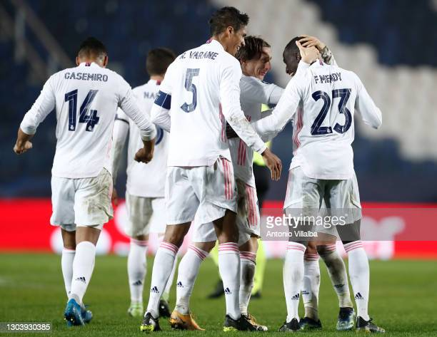Ferland Mendy celebrating goal with Luka Modric and Raphael Varane from Real Madrid CF during the UEFA Champions League Round of 16 match between...