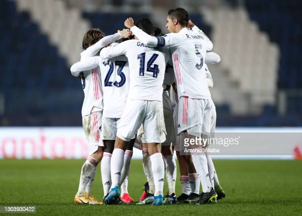 Ferland Mendy celebrating goal with Real Madrid players during the UEFA Champions League Round of 16 match between Atalanta and Real Madrid at Gewiss...