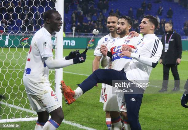 Ferland Mendy Jeremy Morel Nabil Fekir Houssem Aouar of Lyon celebrate the victory following the French Ligue 1 match between Olympique Lyonnais and...