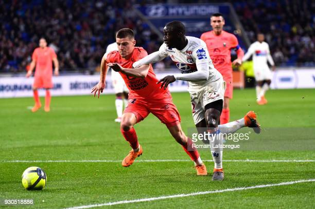 Ferland Mendy of Lyon and Frederic Guilbert of Caen during the Ligue 1 match between Olympique Lyonnais and SM Caen at Parc Olympique on March 11...