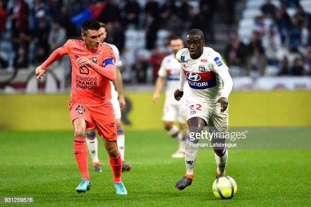Ferland Mendy of Lyon and Julien Feret of Caen during the Ligue 1 match between Olympique Lyonnais and SM Caen at Parc Olympique on March 11 2018 in...