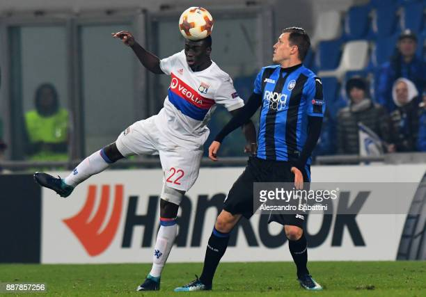 Ferland Mendy of Olympique Lyon competes for the ball whit Josip Ilicic of Atalanta during the UEFA Europa League group E match between Atalanta and...