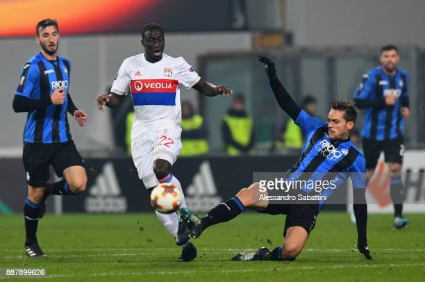 Ferland Mendy of Olympique Lyon competes for the ball whit Rafael Toloi of Atalanta during the UEFA Europa League group E match between Atalanta and...