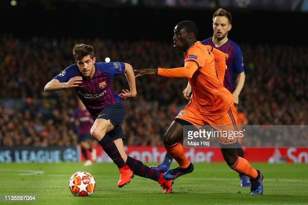 Ferland Mendy of Olympique Lyonnais takes on Sergi Roberto of Barcelona during the UEFA Champions League Round of 16 Second Leg match between FC...