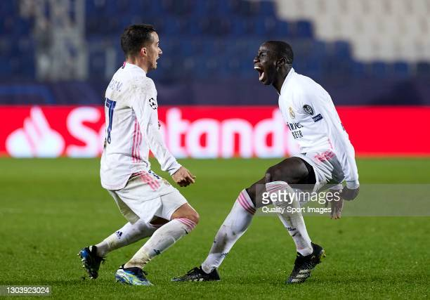Ferland Mendy of Real Madrid celebrates after scoring his team's first goal with his teammate Lucas Vazquez during the UEFA Champions League Round of...