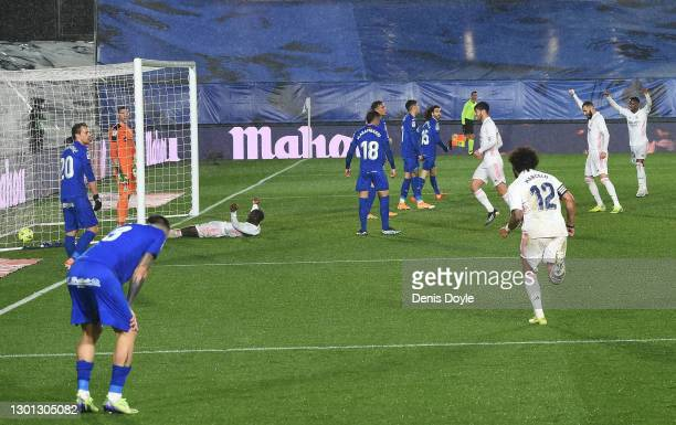 Ferland Mendy of Real Madrid celebrates after scoring their team's second goal during the La Liga Santander match between Real Madrid and Getafe CF...