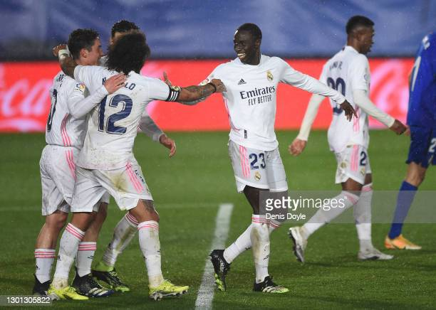 Ferland Mendy of Real Madrid celebrates with Marcelo after scoring their team's second goal during the La Liga Santander match between Real Madrid...