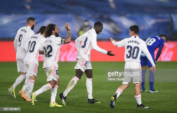 Ferland Mendy of Real Madrid celebrates with Sergio Arribas and Marcelo after scoring his team's 2nd goal during the La Liga Santander match between...