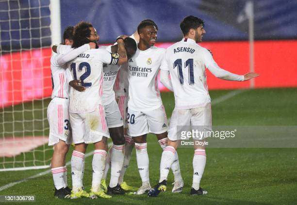 Ferland Mendy of Real Madrid celebrates with teammates after scoring their team's second goal during the La Liga Santander match between Real Madrid...