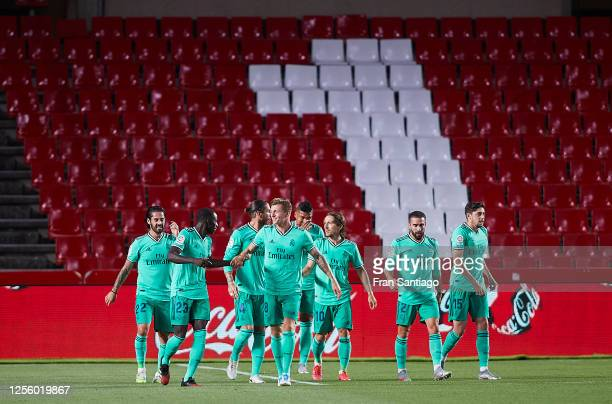 Ferland Mendy of Real Madrid CF celebrates scoring his team's opening goal with team mates during the Liga match between Granada CF and Real Madrid...