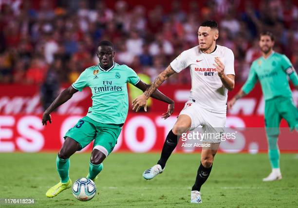 Ferland Mendy of Real Madrid CF duels for the ball with Lucas Ocampos of Sevilla FC during the Liga match between Sevilla FC and Real Madrid CF at...