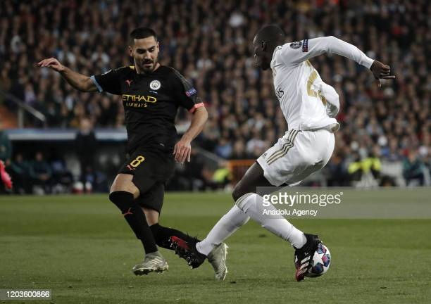 Ferland Mendy of Real Madrid in action against Ilkay Gundogan of Manchester City during the UEFA Champions League round of 16 first leg soccer match...