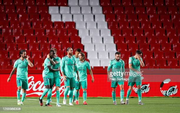 Ferland Mendy of Real Madrid is congratulated after scoring the opening goal during the Liga match between Granada CF and Real Madrid CF at on July...