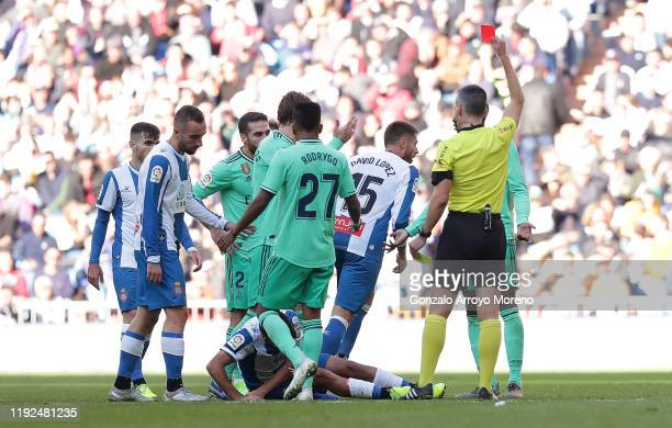 Ferland Mendy of Real Madrid is shown a red card by referee Santiago Jaime Latre during the La Liga match between Real Madrid CF and RCD Espanyol at...