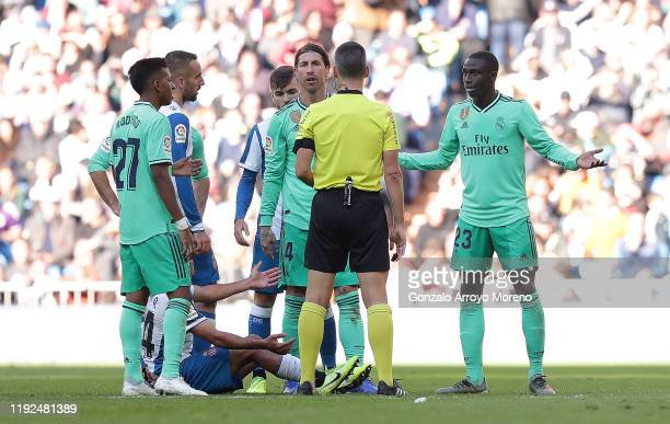 Ferland Mendy of Real Madrid reacts to being sent off by referee Santiago Jaime Latre as Sergio Ramos of Real Madrid argues with him during the La...
