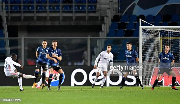 Ferland Mendy of Real Madrid scores their team's first goal during the UEFA Champions League Round of 16 match between Atalanta and Real Madrid at...
