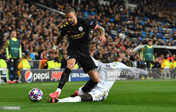 Ferland Mendy of Real Madrid tackles Kyle Walker of Manchester City during the UEFA Champions League round of 16 first leg match between Real Madrid...