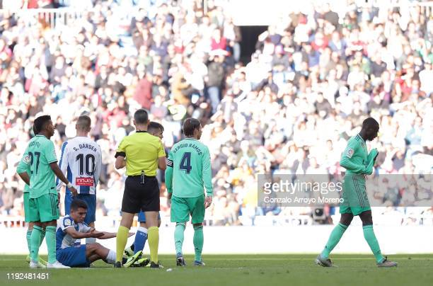 Ferland Mendy of Real Madrid walks off the pitch after being sent off by referee Santiago Jaime Latre during the La Liga match between Real Madrid CF...