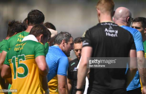 Fermanagh , United Kingdom - 18 July 2021; Michael Murphy of Donegal chats to his team-mates during a water-break, after being sent off earlier in...