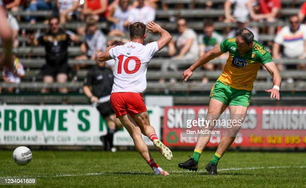 Fermanagh , United Kingdom - 18 July 2021; Michael Murphy of Donegal kicks out at Kieran McGeary of Tyrone, resulting in a red card, during the...