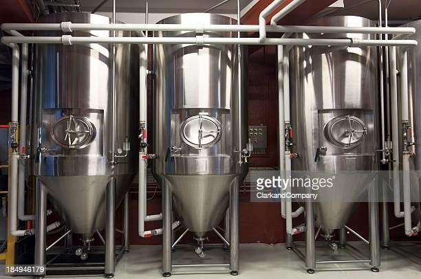 fermentation tanks in a micro brewery - storage tank stock photos and pictures