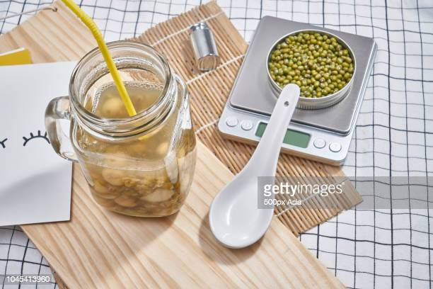 fermented mung bean drink and mung beans, australia - image stock pictures, royalty-free photos & images